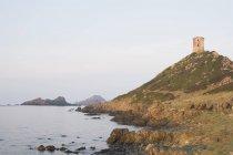 Farol e torre genovesa — Fotografia de Stock