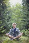 A Man Meditating In The Forest; France — Stock Photo