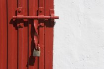Locked Gate over red door — Stock Photo
