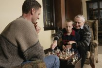 Family Playing Chess at home — Stock Photo
