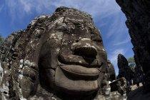 Rostros del templo de Bayon - foto de stock