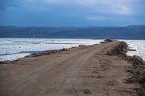 Road crossing dead sea — Stock Photo
