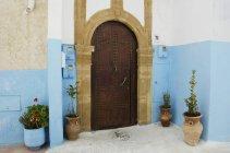 Arched wooden door — Stock Photo