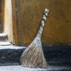 Broom sitting outside a doorway — Stock Photo