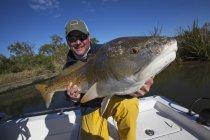 Man holding redfish. Venice, louisiana, united states of america — Stock Photo