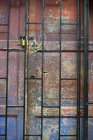 Padlock On Weathered Door — Stock Photo