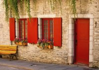 Red Doors And Window Shutters — Stock Photo