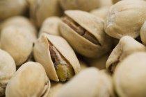 Closeup view of dried pistachio nuts heap — Stock Photo