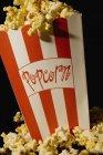 Salted tasty popcorn in bucket, closeup — Stock Photo