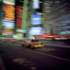 Blurred Taxi Driving With City Background At Night, New York City, Usa — Stock Photo