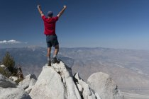 Male Hiker With Arms Raised — Stock Photo