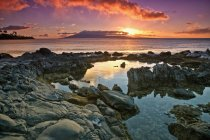 Sunset reflected in  tide pools — Stock Photo