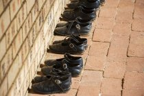 Shoes neatly organized in orphanage — Stock Photo