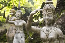 Buddhist statues in Garden — Stock Photo