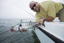 Fisherman holds false albacore. Cape Cod, Massachusetts, United States of America — Stock Photo
