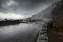Rain on a wet bridge — Stock Photo
