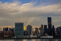 Sun setting behind United Nations — Stock Photo