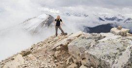 Female hiker poses alone — Stock Photo