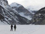 People walking on frozen Lake — Stock Photo