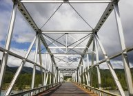 Metal Bridge over the Racing River — Stock Photo