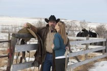 Happy caucasian adult couple on ranch — Stock Photo