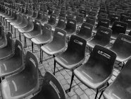 Black and white image of Chairs in a row — Stock Photo