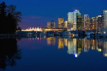 Reflection Of Vancouver's Skyline In The Evening; Vancouver, British Columbia, Canada — Stock Photo