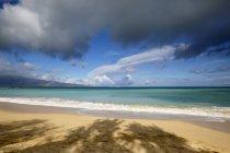 Rainbow over ocean and Baldwin Beach, on the North shore of Maui; Paia, Maui, Hawaii, United States of America — Stock Photo
