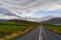 Road leading into the distance on the Trollaskagi peninsula, Northern Iceland; Iceland — Stock Photo