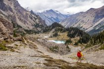 Male hiker in Royal Basin, Olympic Mountains, Olympic National Park; Washington, United States of America — Stock Photo