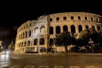 Ancient Roman Amphitheatre known as Pula Arena at night; Pula, Istria, Croatia — Stock Photo