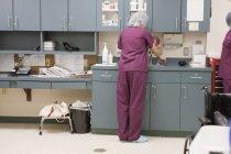 Female nurse washing her hands — Stock Photo