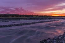Sunset over the Muddy River in Denali National Park and Preserve; Alaska, United States of America — Stock Photo