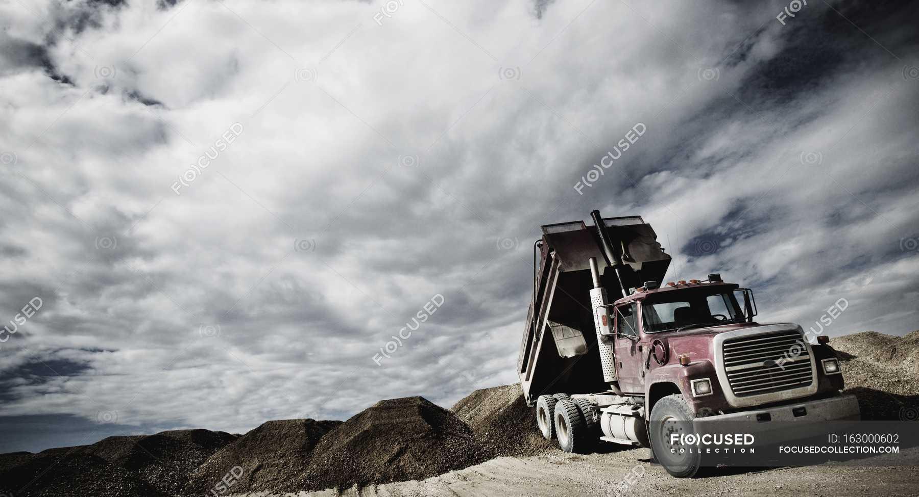Dump Truck Unloading Stock Photo