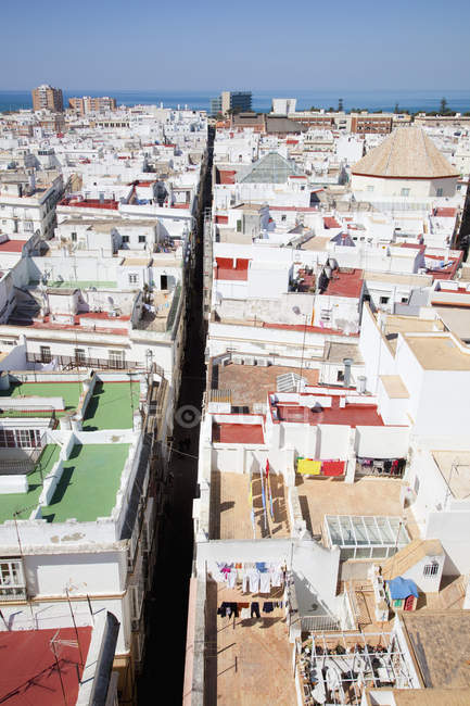 Rooftops and ocean, spain — Stock Photo