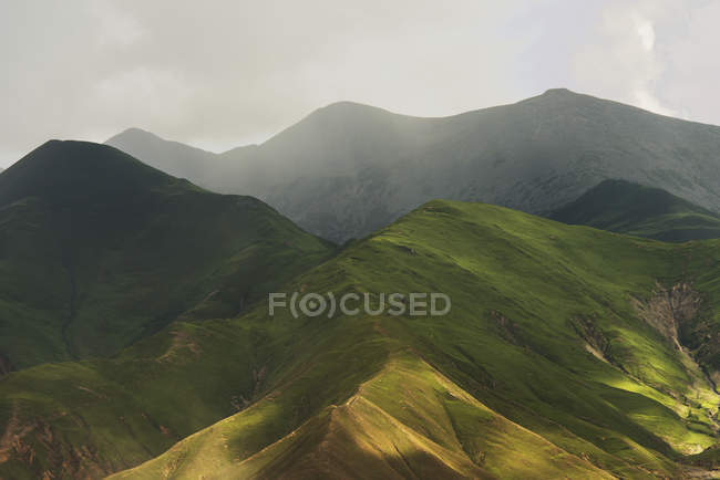 Sunlight and clouds cast patterns — Stock Photo