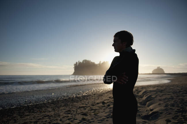Young Man Stands On Beach — Stock Photo