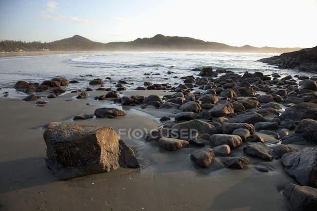 Sandy beach with stones — Stock Photo