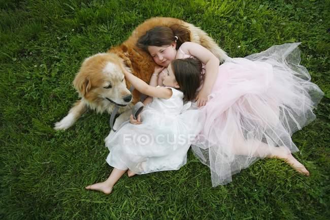 Two Sisters Hug Dog, — Stock Photo