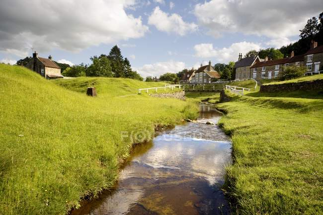 Stream By A Village — Stock Photo