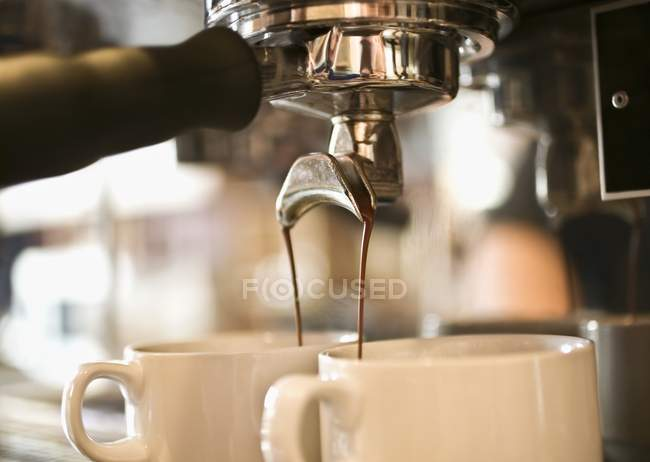 Pouring A Beverage from coffee machine at bar — Stock Photo