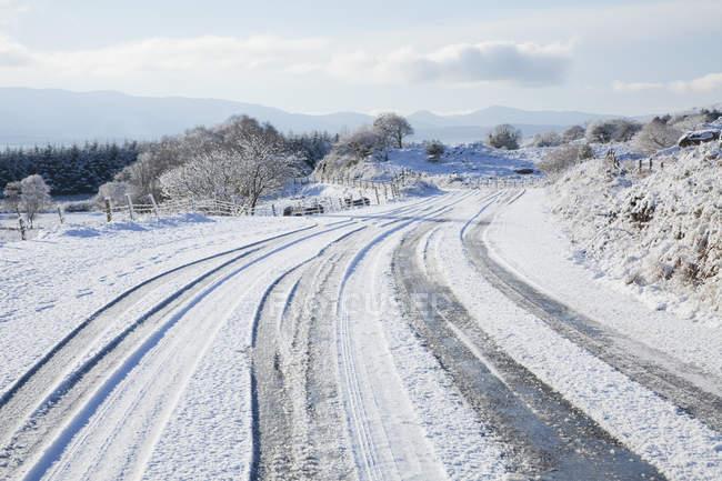 Estrada coberto de neve — Fotografia de Stock