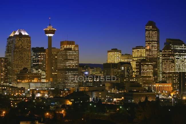 Illuminated buildings of city — Stock Photo