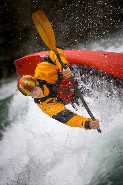 Caucasian Boy In Orange Uniform Kayaking On River — Stock Photo