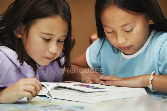 Close-up view of cute little students studying together — Stock Photo