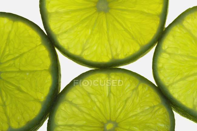 Slices Of Green Lime — стоковое фото