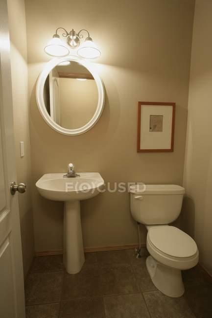 Modern bathroom interior with sanitaryware and furniture — Fotografia de Stock