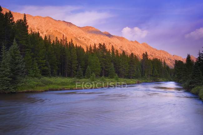 Mountain Sunset with rapid river — Stock Photo