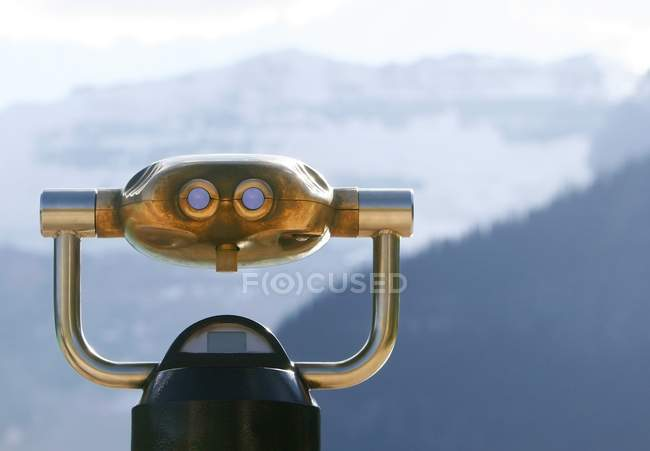 Binoculars For Closer View Of Landscape In Front Of Misty Mountains — Stock Photo