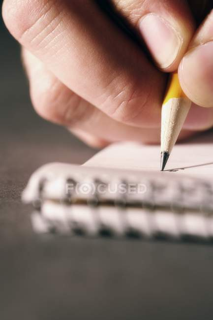 Closeup View Of Person Writing On Paper — Stock Photo